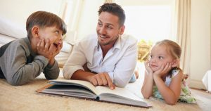 Dad reading with his two kids