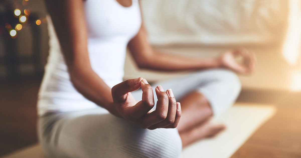 Woman sitting cross-legged, meditating