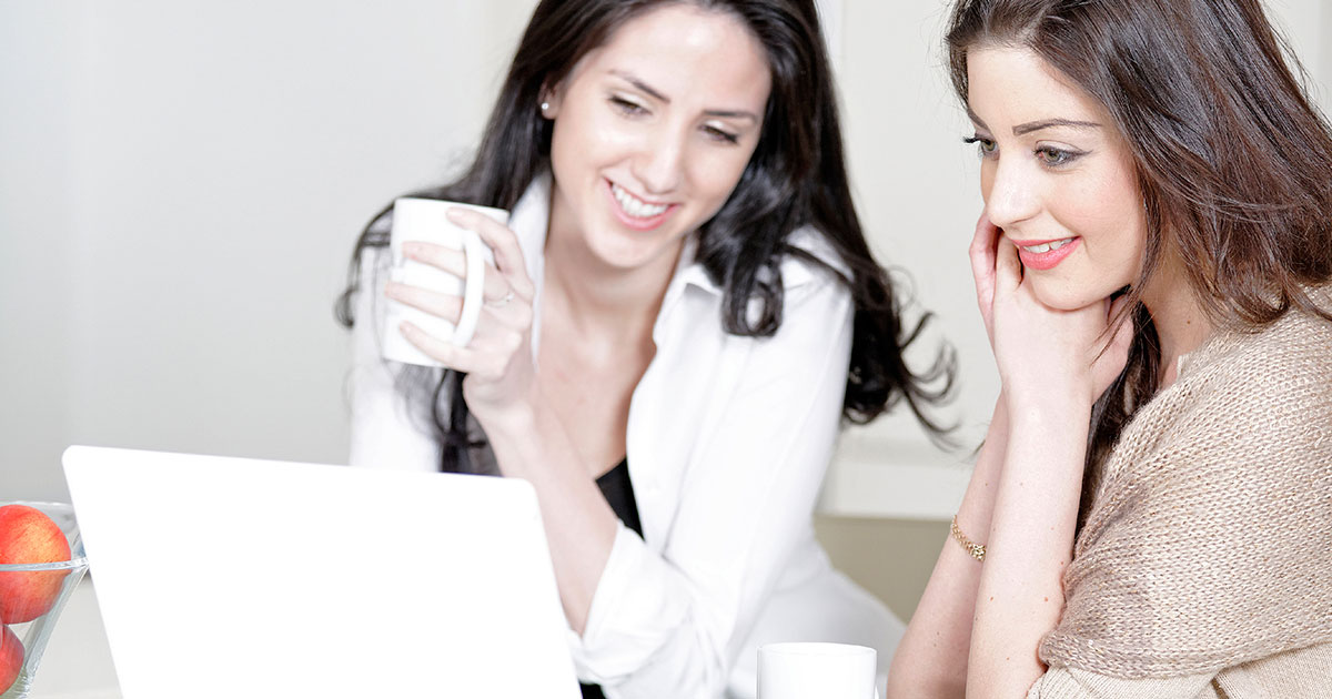 Two women looking at laptop screen