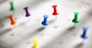 Tacks stuck in a calendar