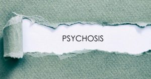 "Paper torn back to reveal ""psychosis"""
