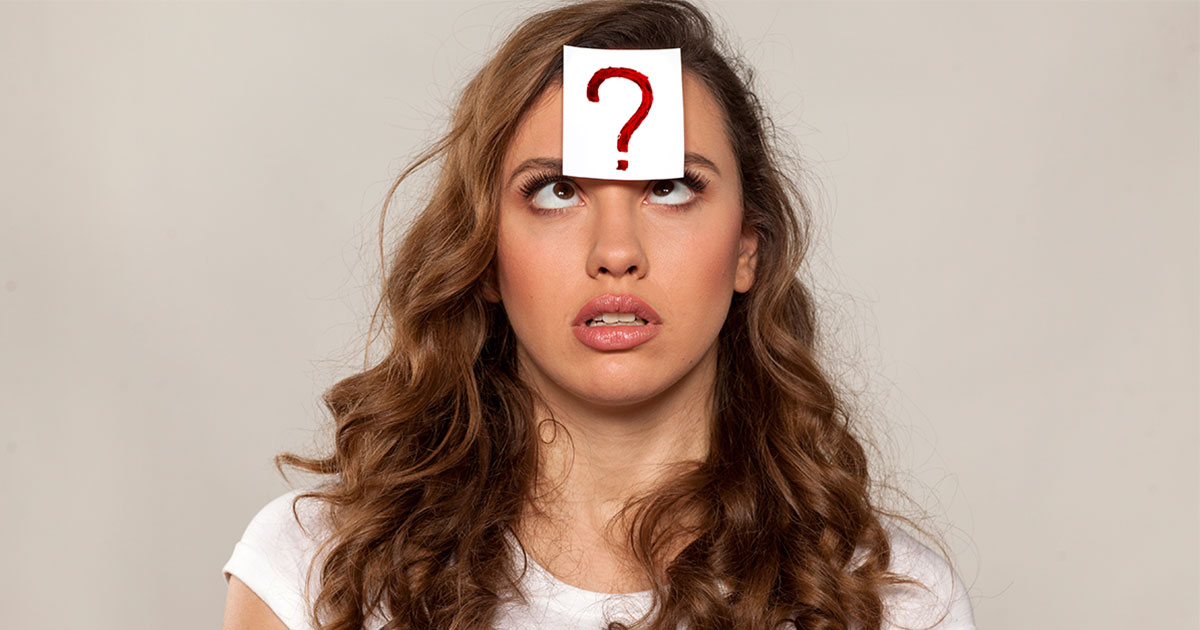 Woman with question mark stuck on forehead