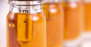 Bottles of yellow liquid