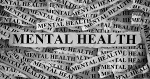 Mental health written on pieces of paper in a pile