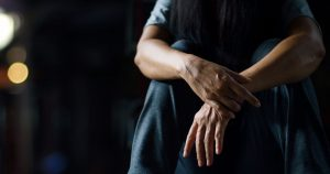 an individual experiencing the depressive symptoms common to ptsd and bipolar disorder